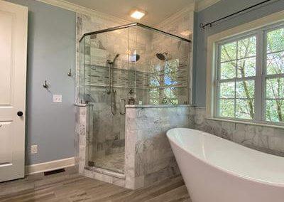 Beautiful Bathroom with Frameless Shower Enclosure